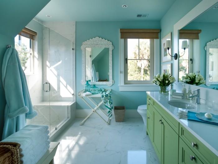belle-suggestion-salle-de-bain-bleue-cabine-de-douche-gros-miroir-double-vasque-à-encastrer-ambiance-sereine-propice-au-repos