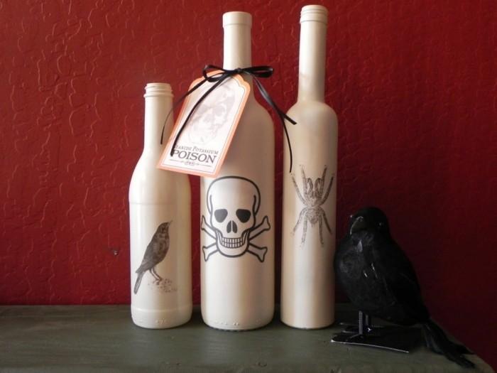 bouiteilles-peintes-en-blancs-et-decorees-avec-des-motifs-halloween
