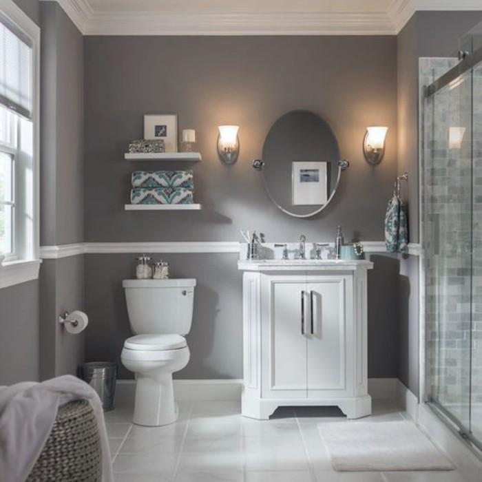 couleur-salle-de-bain-grise-coiffeuse-élégante-miroir-ovale-panier-en-rotin-à-linge-WC-cabine-de-douche