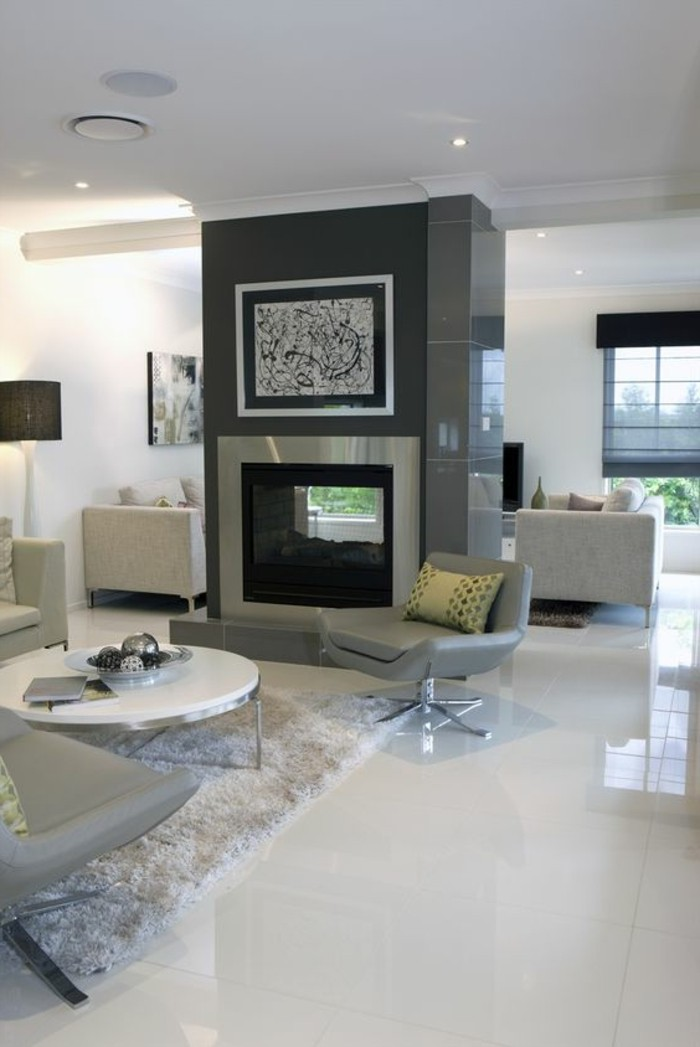 carrelage-blanc-hall-cheminee-fauteuil