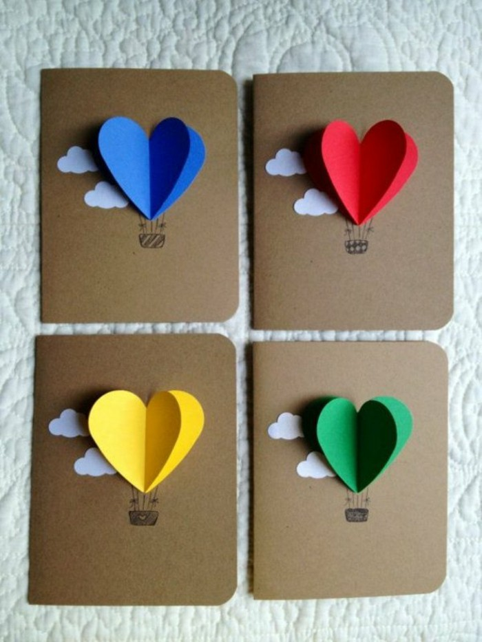decoupage-faire-part-creatif-en-carton-avec-des-coeurs-origami-colores