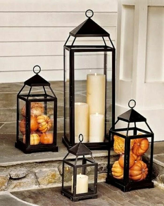 idee-deco-halloween-avec-lanterne-noir-et-citrouilles-oranges-bougies-decoratives