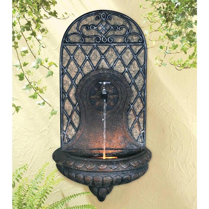 jardin-mediterraneen-oriental-marocain-idee-decoration-design-fontaine-murale-fer-forge