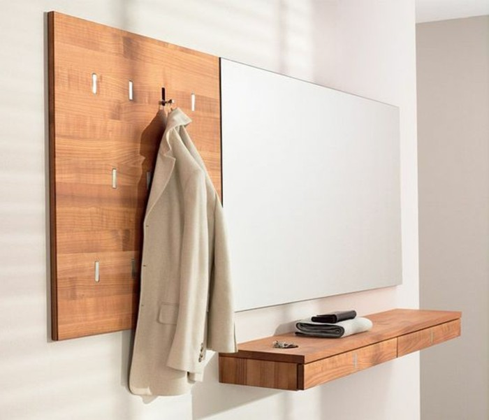 42-meuble-vestiaire-entree-variante-en-bois-un-manteau-blanc-est-accroche