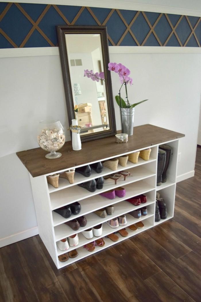 69 banc range chaussures un miroir une orchidee meuble