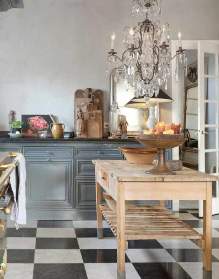 carrelage-damier-noir-et-blanc-table-bois-lustre-fausses-bougies