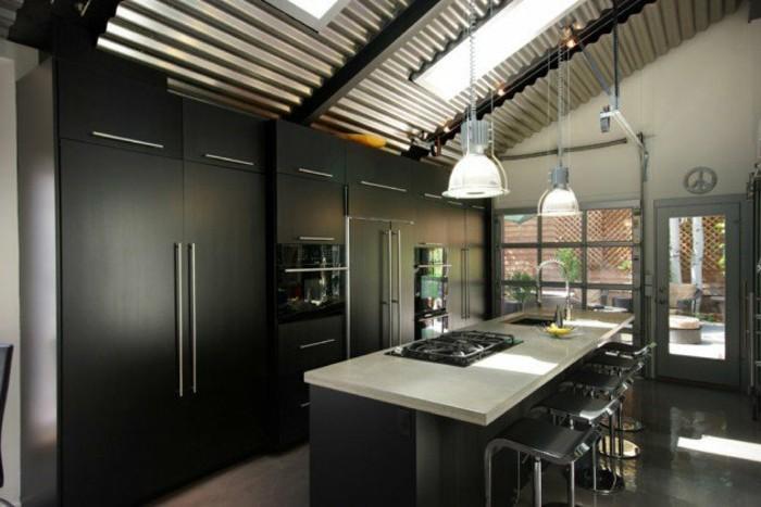 cuisine-industrielle-ultra-moderne-meubles-industriels-noirs-plan-de-travail-blanc-suspensions-industrielles-decor-sobre-depouille