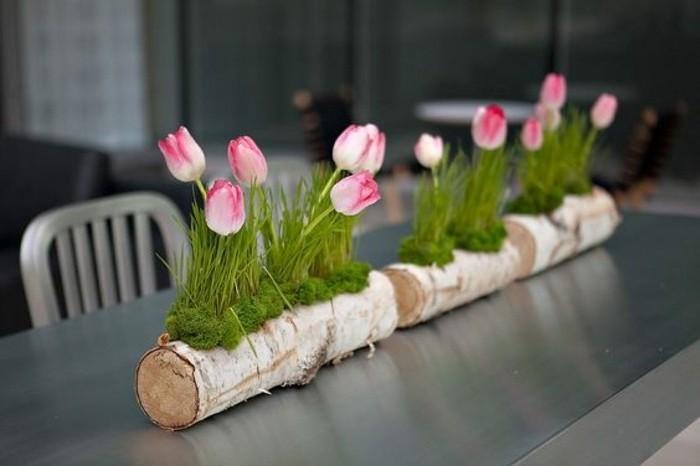decoration-de-paques-charmante-grosse-branche-d-arbre-qui-recoit-des-fleurs