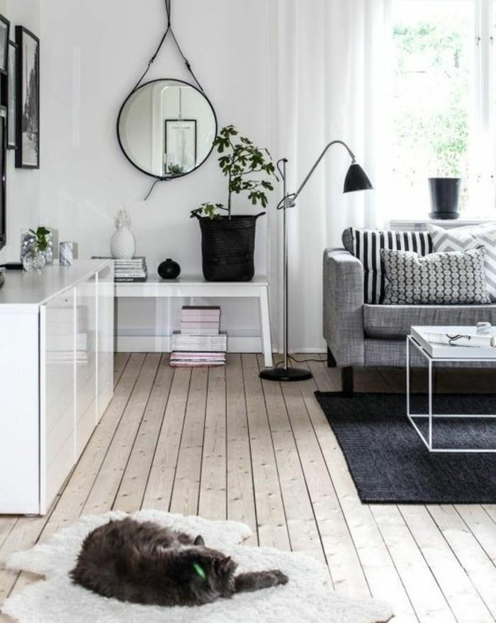 deco-salon-blanc-avec-des-accents-gris-canape-gris-tapis-couleur-gris-anthracite-ambiance-calme