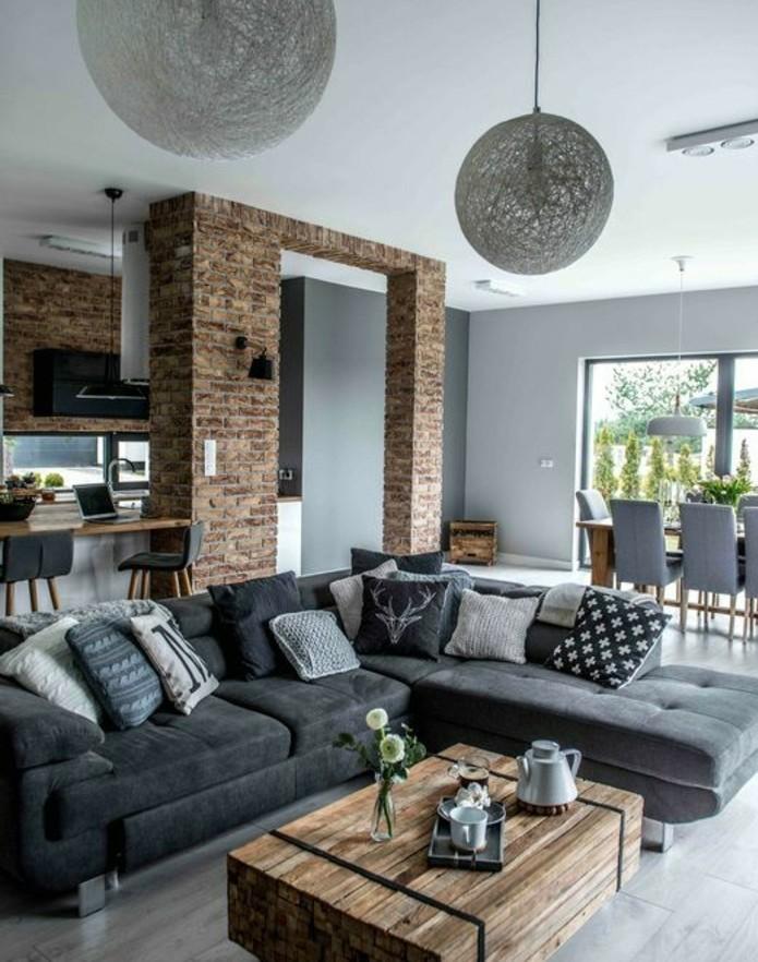 formidable studio avec un salon gris et blanc, canapé gris anthracite