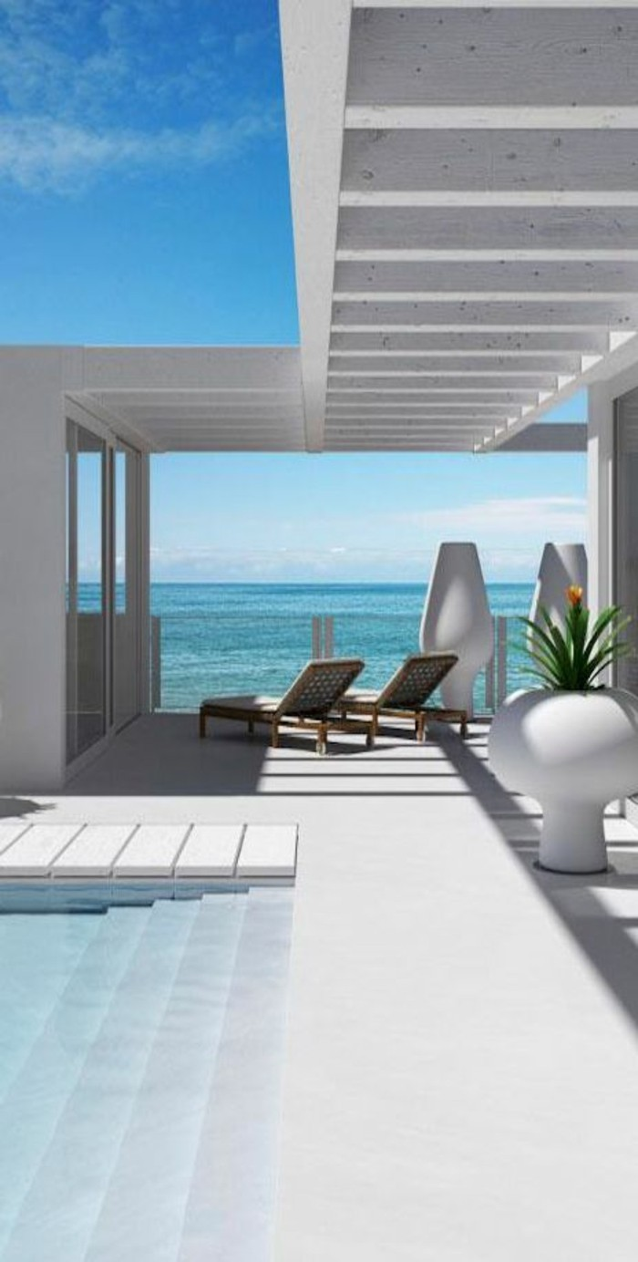 immobilier-espagne-bord-de-mer-piscine-eau-sol-blanc