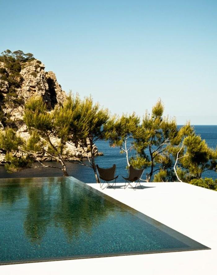 immobilier-espagne-bord-de-mer-piscine-moderne-clair-air-eau