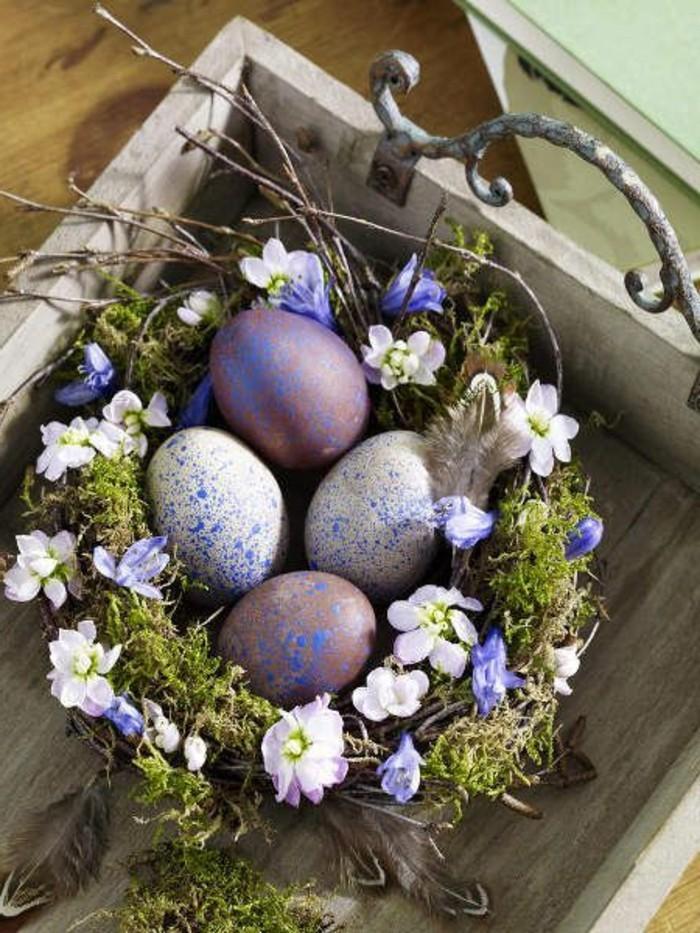 joli-nid-plein-d-herbe-de-fleurs-douces-et-d-oeufs-idee-coloriage-oeufs-originale-deco-paques-tres-jolie