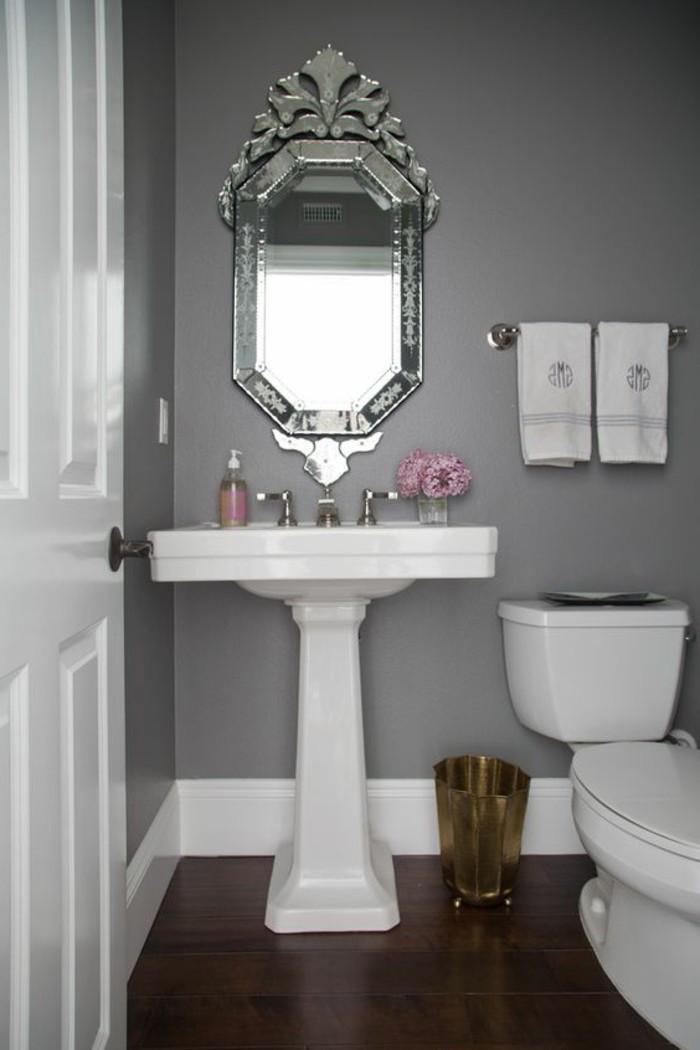 lavabo-colonne-vasque-blanche-miroir-oval-carrelage-gris