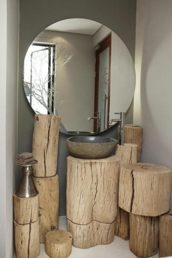lavabo-en-pierre-grand-miroir-rond-accroche-au-mur