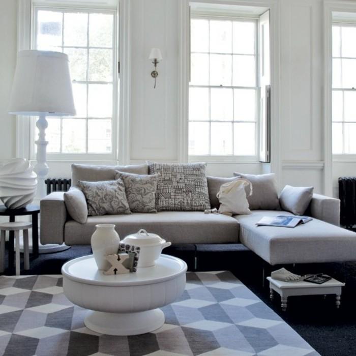 peinture-murale-blanche-canape-gris-table-blanche-design-extravagant-tapis-blanc-et-gris-ambiance-propice-a-la-detente
