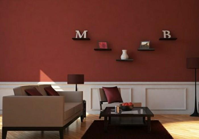 peinture-murale-salon-en-rouge-fonce-couleur-de-peinture-pour-salon-canape-beige-coussins-rouges