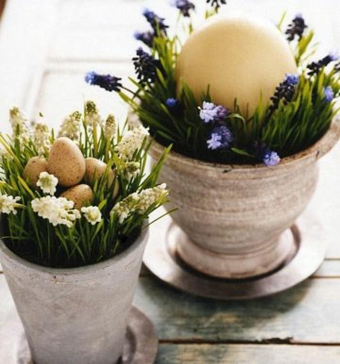 pots-de-fleurs-en-pierre-decores-d-herbe-de-fleurs-fraiches-et-oeufs-colores