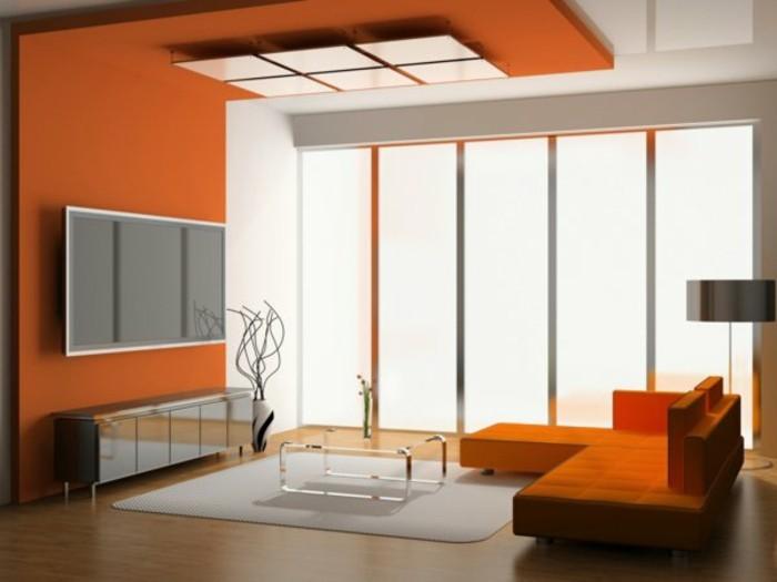 salon-chic-couleur-de-peinture-pour-salon-mur-orange-tapis-beige-table-en-verre-lampe-de-lecture