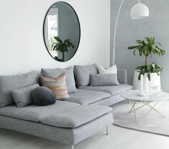 salon-gris-et-blanc-aux-lignes-epurees-gros-canape-gris-table-a-cafe-style-scandinave