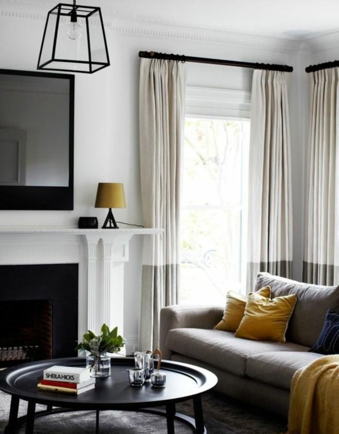 salon-gris-et-blanc-avec-des-eclats-noirs-peinture-murale-blanche-canape-gris-tapis-gris-table-noire-deisgn-exceptionnelle