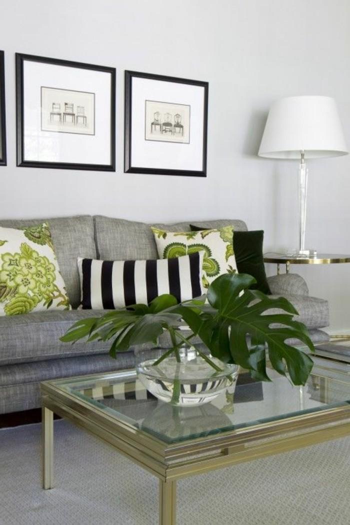 salon-gris-et-blanc-peinture-murale-blanche-canape-gris-elements-decoratifs-verts-amenagement-salon-naturel