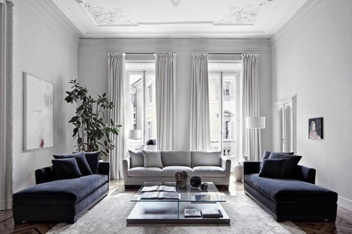 salon-tres-charmant-et-spacieux-canapes-couleur-bleu-marine-sensation-de-grandeur-deco-salon-blanc-avec-des-touches-de-gris-et-de-bleu