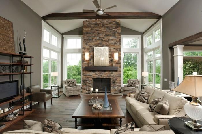 un-interieur-de-luxe-tres-moderne-salon-taupe-cheminee-en-pierre-table-basse-en-bois