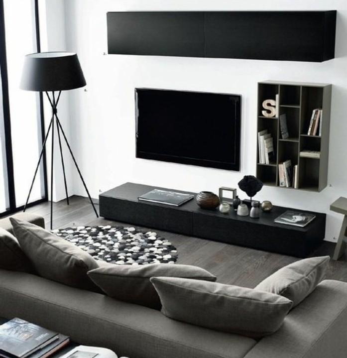 un-salon-en-noir-blanc-et-gris-idee-deco-salon-aux-lignes-epurees-peinture-murale-blanche-canape-gris-lampe-design-et-meuble-tv-noirs