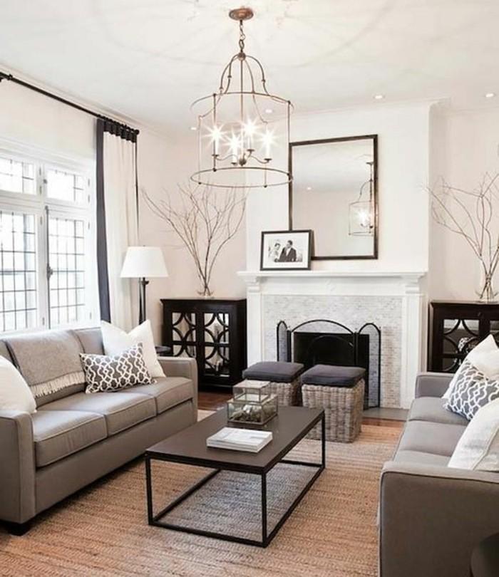 un-salon-tres-charmant-canapes-gris-magnifique-cheminee-et-peinture-murale-blanche-lustre-design-extraordinaire-amenagement-salon-exquis