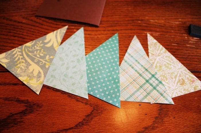 des-motifs-d-arbres-de-noel-a-decouper-dans-du-papier-a-motifs-multicolores-carte-de-noel-a-fabriquer