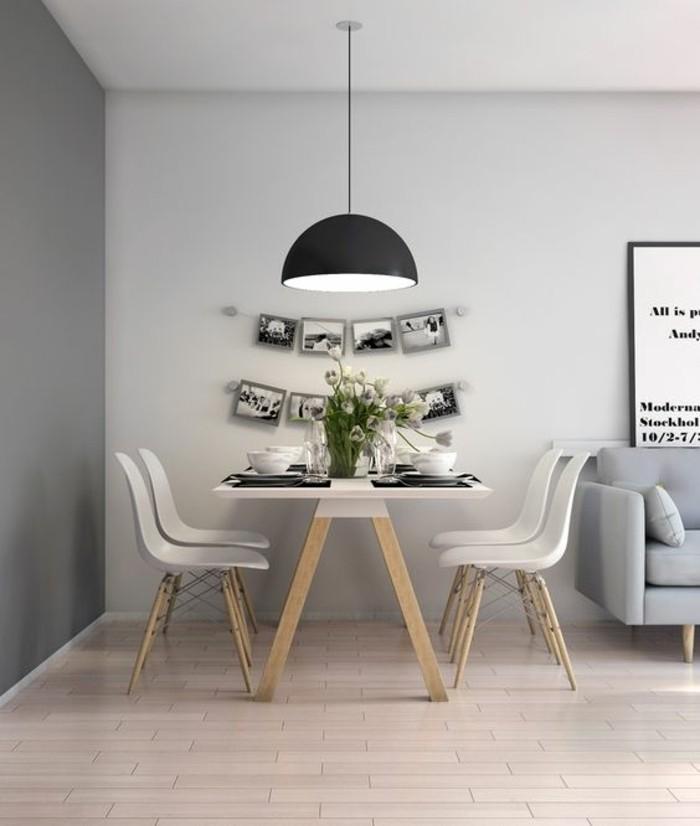 chaise-en-pastique-beige-table-a-pieds-bois-mur-gris-fonce-gris-clair-canape-gris