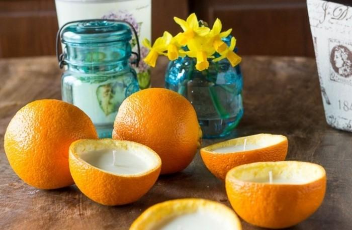 de-la-cire-versee-dans-de-l-ecorce-d-orange-idee-interessante-pour-fabriquer-des-bougies-avec-un-parfum-naturel