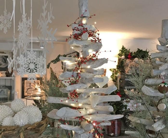 decoration-naturelle-pour-ce-sapin-en-bois-branches-peintes-en-blanc-ambiance-festive