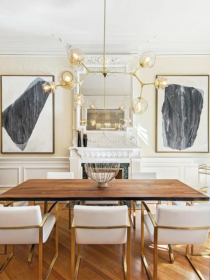 meubles-de-salle-a-manger-chaises-encadrement-dore-tableaux-artistiques