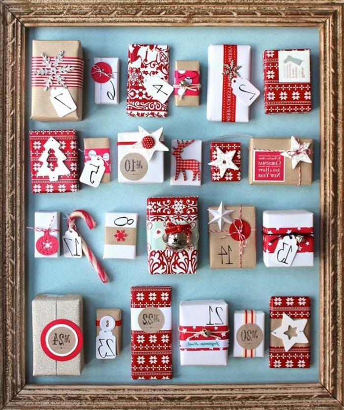 petites-boites-a-surprises-en-rouge-et-blanc-posees-dans-un-cadre-calendrier-de-l-avent-a-fabriquer