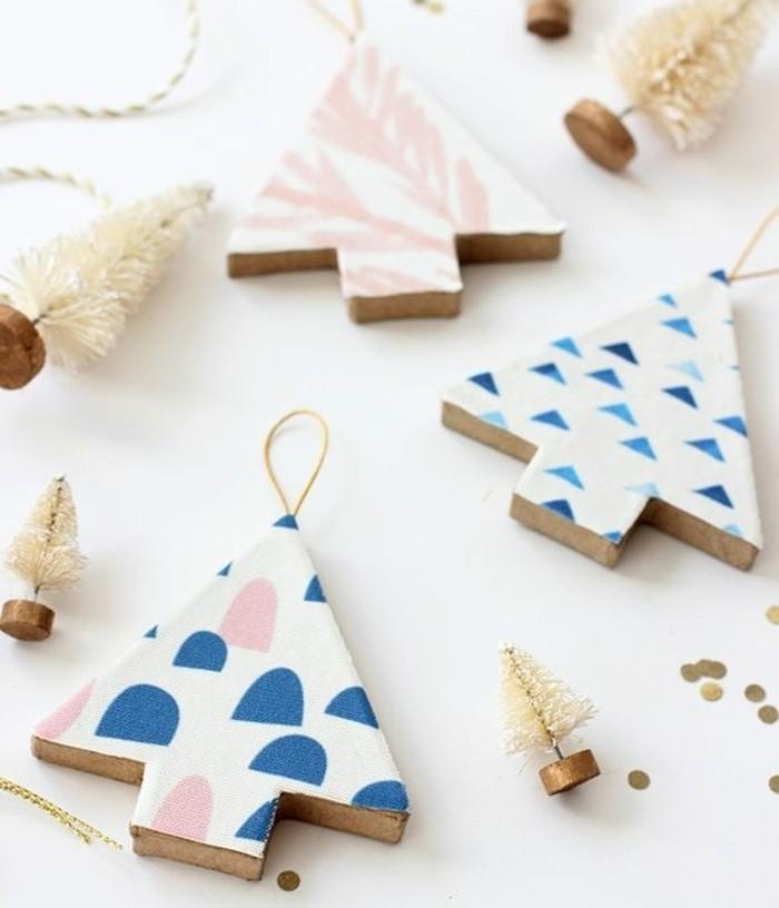 petits-elements-en-bois-en-forme-de-sapins-de-noel-decores-de-motifs-festifs-bricolage-noel-interessant