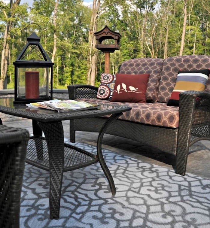 salon de jardin en résine tressée noir patio design extérieur