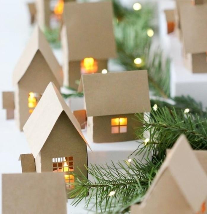 un-petit-village-charmant-sous-l-emprise-de-la-neige-petites-maisons-en-carton-idee-fantastique-de-decoration-de-noel-a-fabriquer