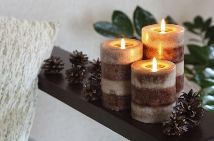 une-magnifique-decoration-maison-bougies-en-blanc-et-marron-et-cones-de-pin