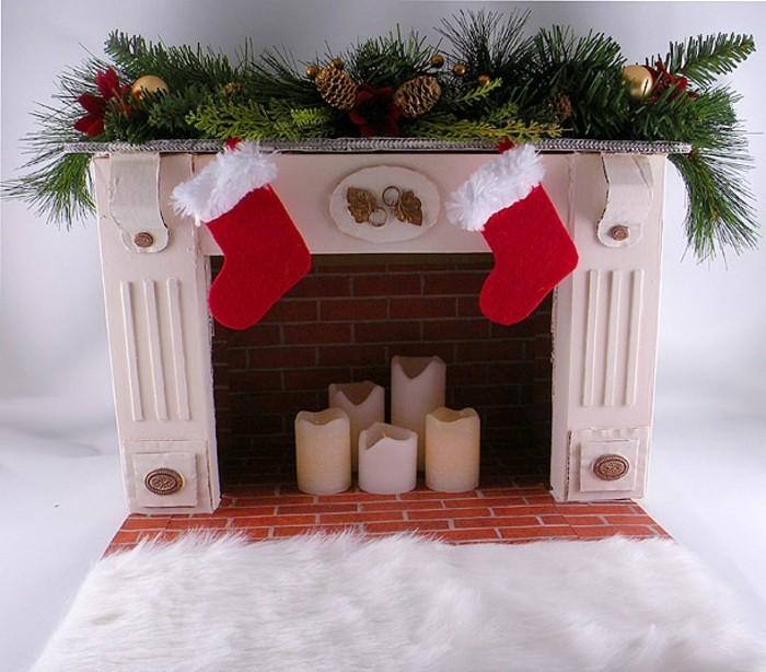 cheminee-en-carton-bougies-blanches-guirlande-verte