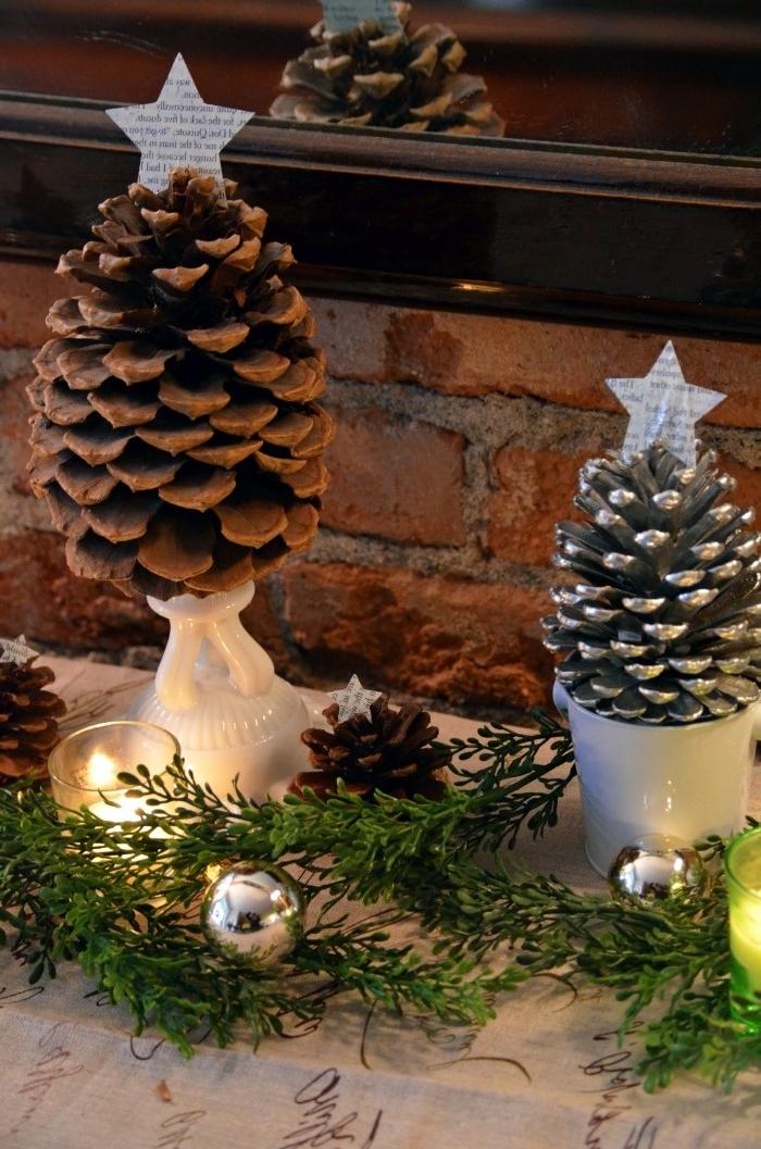 que peut on faire avec des pommes de pin, idée déco de cheminée pour Noël avec mini sapins en pommes de pin