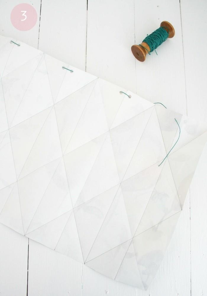 faire-des-trous-avec-une-perforatrice-et-passer-un-fil-tout-au-long-pour-fabriquer-un-abat-jour