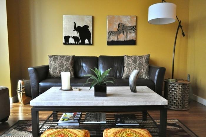 stickers-afrique-table-en-marbre-lampe-blanche-coussins-en-motifs-animaux-tabourets-ethniques