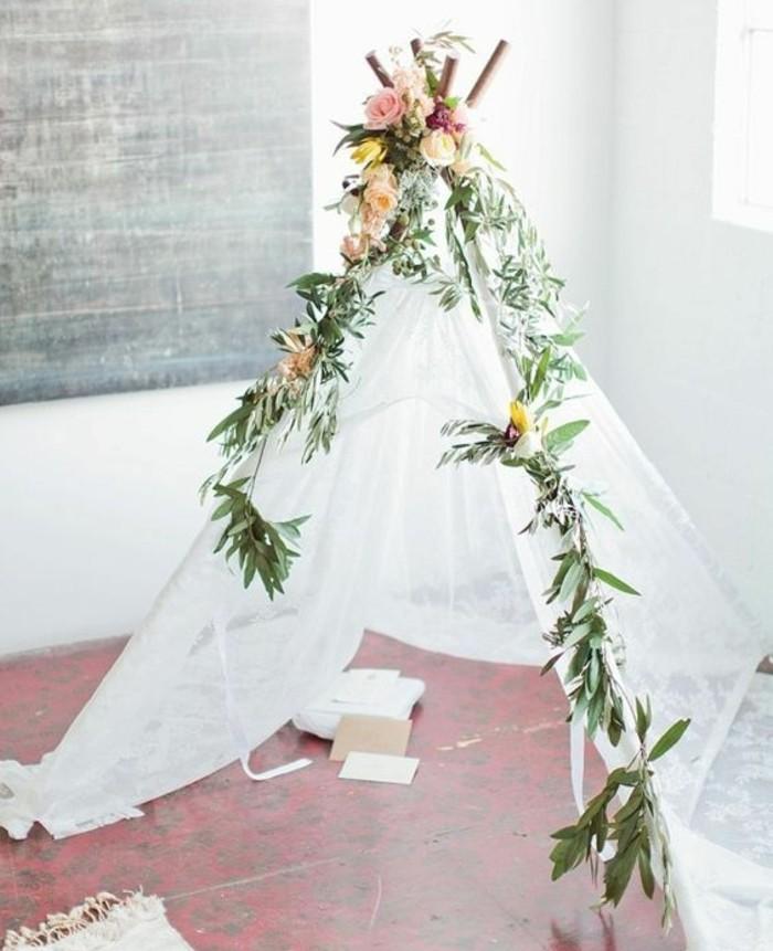 une-toile-legere-transparente-decoration-naturelle-de-branches-et-de-fleurs-tipi-interieur