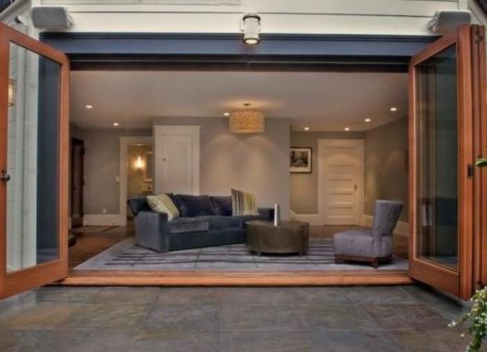 amenager-un-garage-en-chambre-meubles-en-velour-table-ronde-espace-ouvert