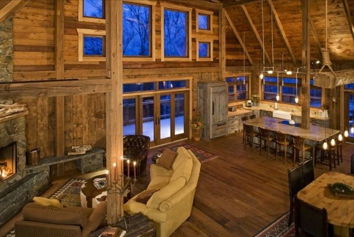 amenager-une-grange-air-rustique-cheminee-allumee-ambiance-accueillante-canape-en-cuir-bougies