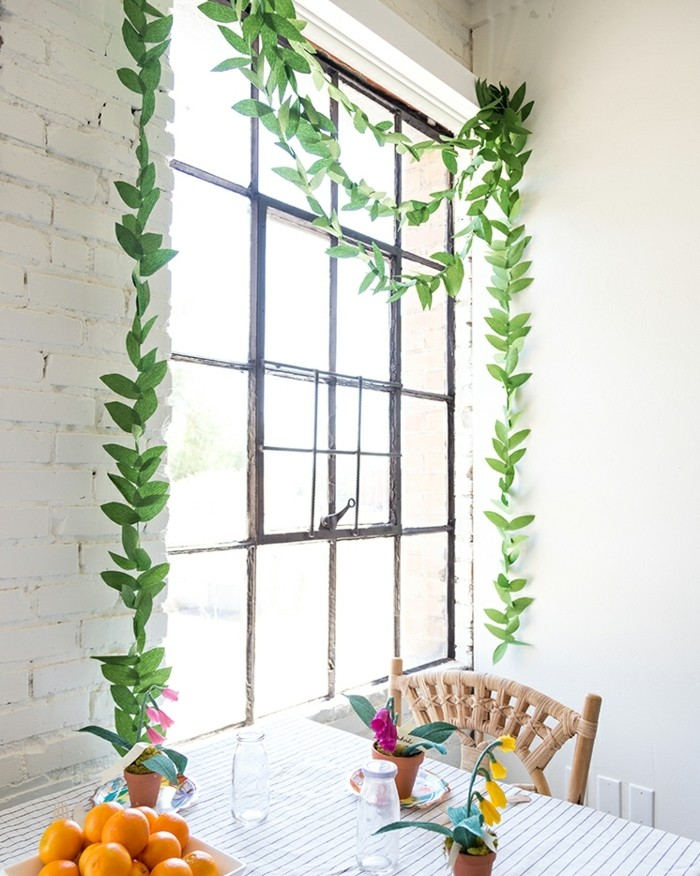 comment-faire-des-guirlandes-exemple-de-guirlande-composee-de-feuilles-vertes-en-papier-deco-naturelle