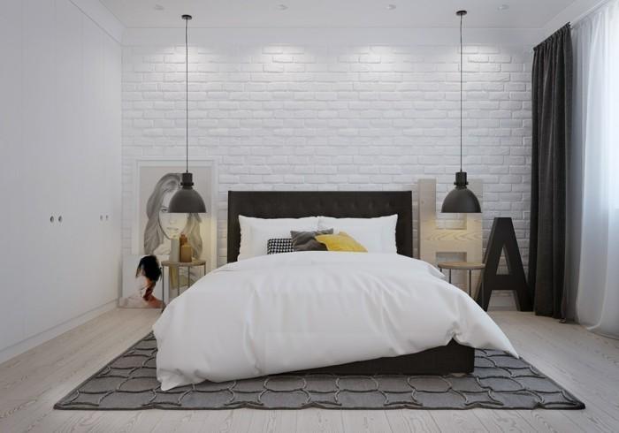 decoration-scandinave-avec-des-petites-touches-d-industriel-briques-blanchies-tableau-d-art-comme-point-focal-suspensions-industriels-tapis-gris