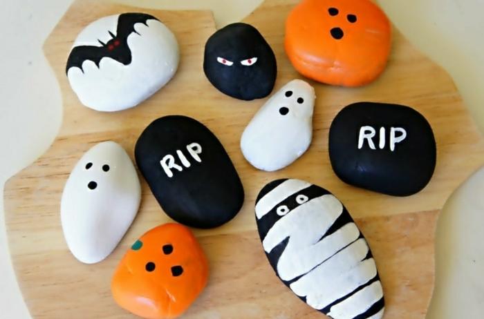 des-galets-peints-a-la-peinture-acrylique-motifs-halloween-idee-comment-decorer-des-galets-pour-créer-une-deco-halloween-a-faire-soi-meme